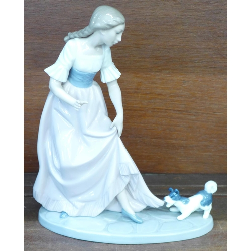659 - Three Nao by Lladro porcelain figures, Puppy Tugging Girl's Skirt, Lets Play, model no. 02001023, de...