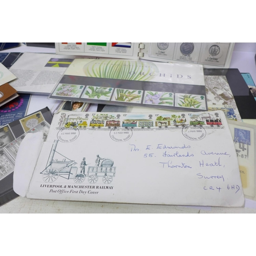 660 - Assorted postcards, coins and stamps...