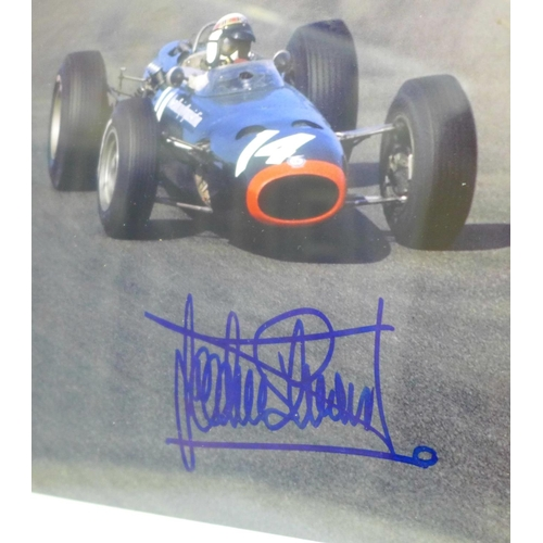 662 - A framed signed photograph of Jackie Stewart...