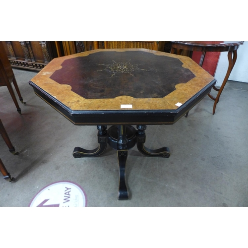 104 - A Victorian Aesthetic Movement amboyna and ebonised octagonal centre table...
