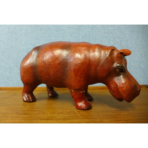 38 - A small leather figure of a hippopotamus, 30cms l...