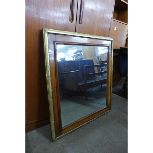 42a - A Victorian walnut and parcel gilt framed mirror, 87 x 78cms...