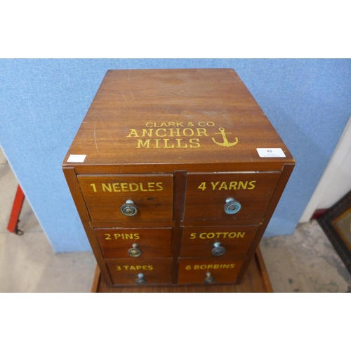 43 - A beech six drawer counter top haberdashery cabinet, bearing Clark & Co, Anchor Mills inscription...