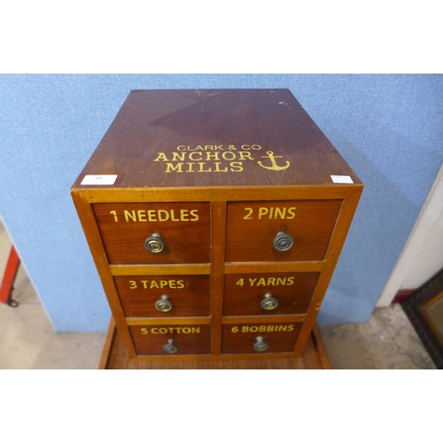 44 - A beech six drawer counter top haberdashery cabinet, bearing Clark & Co, Anchor Mills inscription...
