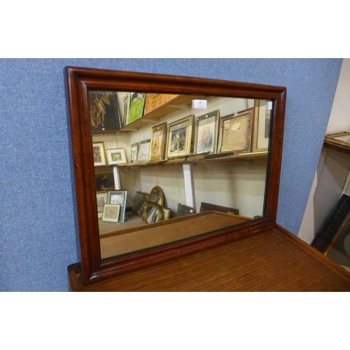 58 - A Victorian walnut cushion framed mirror, 48 x 64cms...