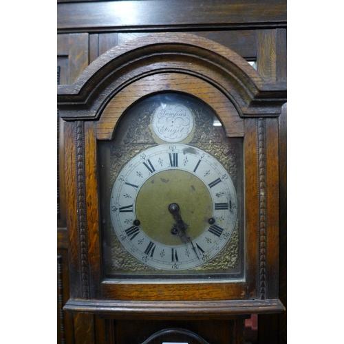 62 - An oak dwarf longcase clock...