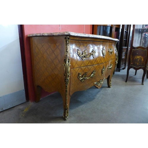 76 - A French Louis XV style parquetry rosewood, gilt metal and marble topped bombe shaped commode, 83cms...
