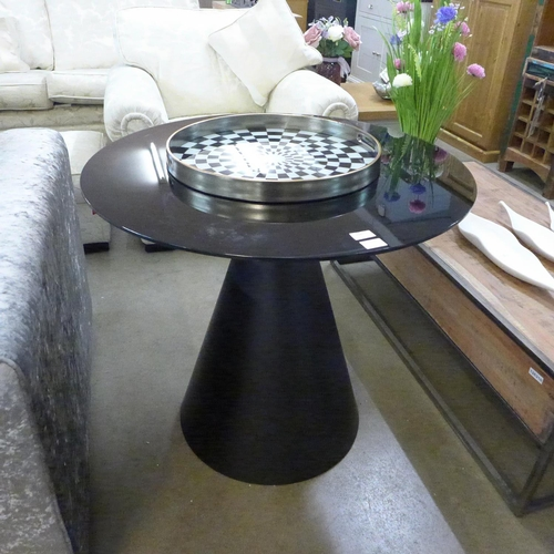1340 - A black glass conical based table * this lot is subject to VAT...