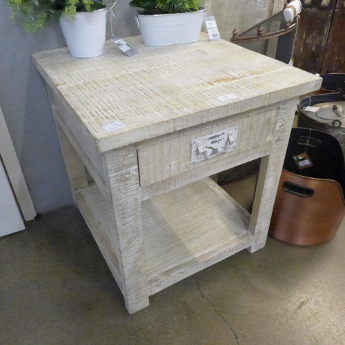 1303 - A rustic rough sawn lamp table * this lot is subject to VAT