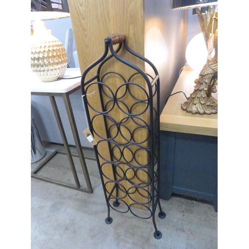 1351 - A wrought iron twelve bottle wine rack (1458917)   #