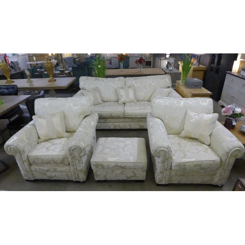 1382 - A gold floral sofa, two chairs and a footstool...