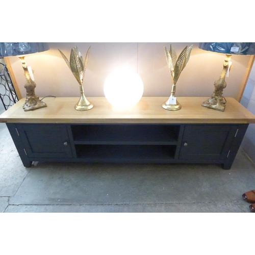1390 - An oak and blue large TV stand  *This lot is subject to VAT...