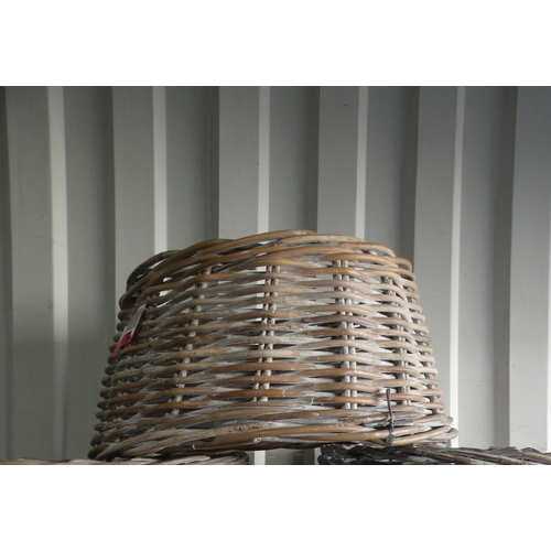 3001 - Three Kubu wicker style tree base covers * this lot is subject to VAT...