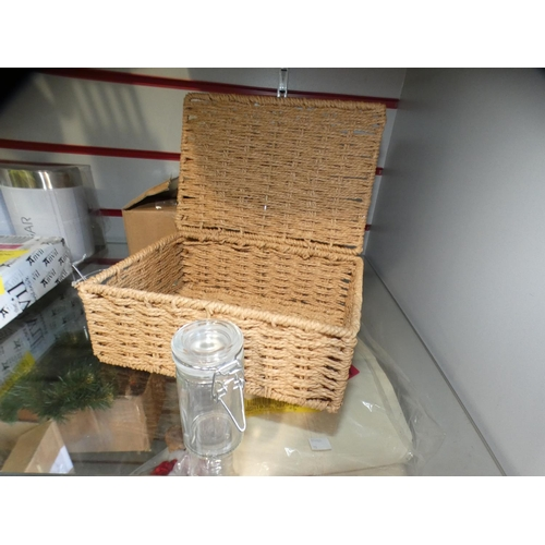 3007 - A wicker style small container and twelve small glass lidded bottles * this lot is subject to VAT