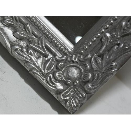 3021 - A small silver carved framed mirror (28x32cm) * this lot is subject to VAT...