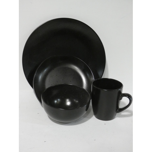 3054 - A black stoneware dinner set * this lot is subject to VAT...