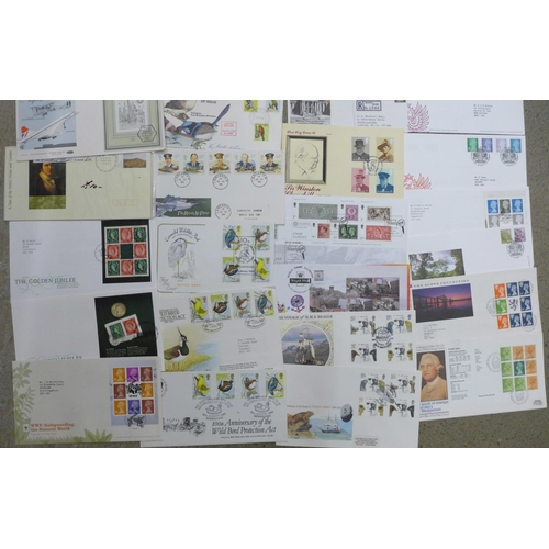 614 - Thirty-one stamp first day covers, including some higher value definitives...