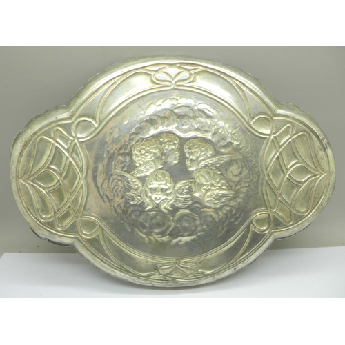 617 - A plated dressing table tray with Reynolds angels, marked J.C. & Co. Ltd., 30cm...