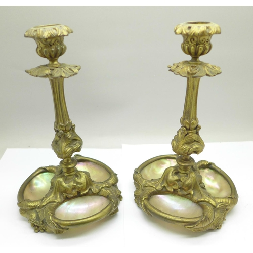 620 - A pair of 19th Century French ormolu candlesticks, each set with three shells, 19.5cm...
