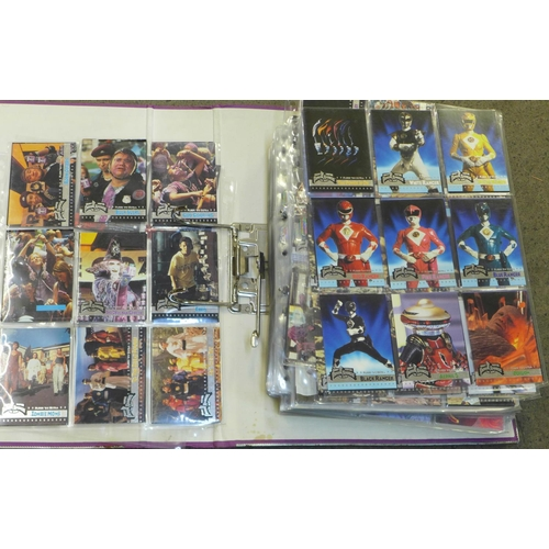 642 - An album of collectors cards, including Justice League, Power Rangers, Marvel, 007, etc....