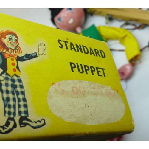 646 - Two vintage Pelham puppets; Dutch girl and boy, with one box marked Dutch Boy...