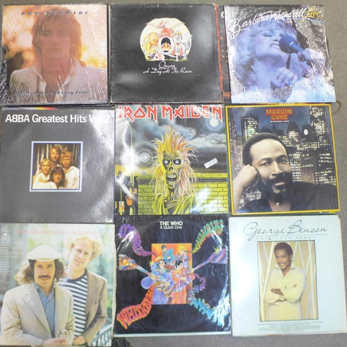 652 - A collection of thirty-two LP records, Lennon, Tubular Bells, Iron Maiden, etc., (Ian Dury sleeve on...