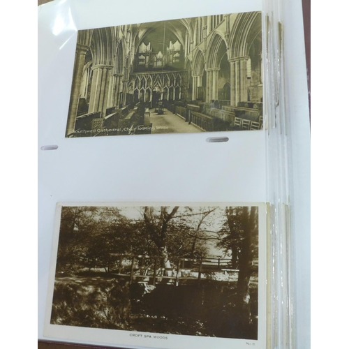 660 - An album of 140 Edwardian and later postcards...