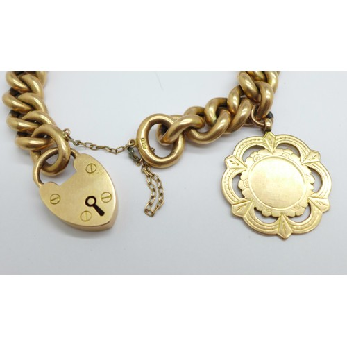 1103 - A 15ct gold bracelet with a 9ct gold fob medal charm, total weight 42.5g, marked 15ct on padlock and...