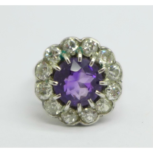 942 - A platinum set, amethyst and diamond cluster ring, approximately 1.5ct diamond weight, 5.9g, M, (clu...