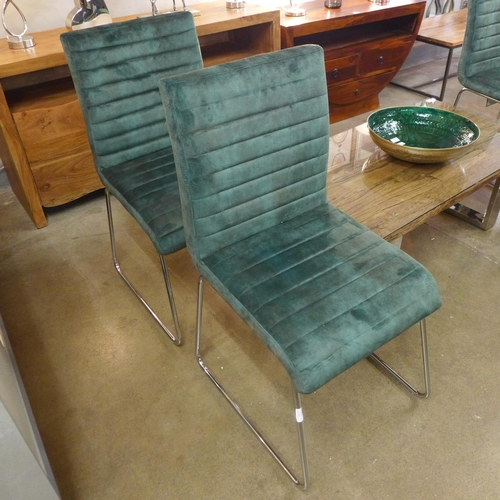 1538 - A set of four emerald green Aaryan dining chairs
