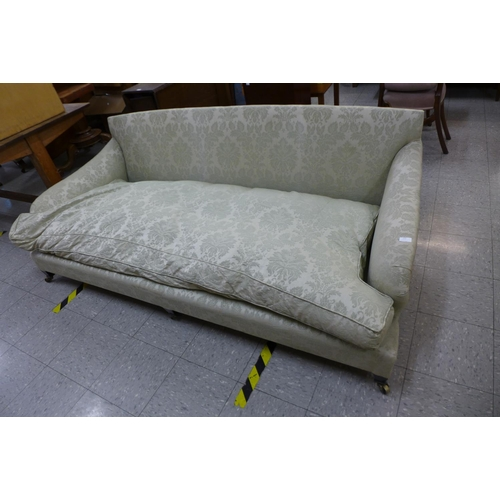195 - A Victorian mahogany and fabric upholstered country house settee, manner of Howard & Sons...