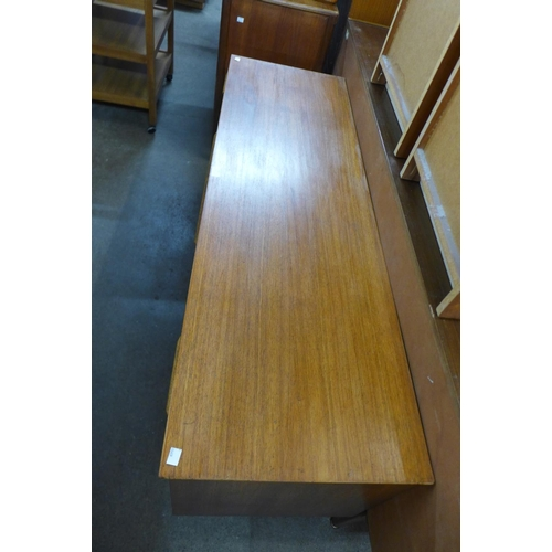 228 - A small teak sideboard...