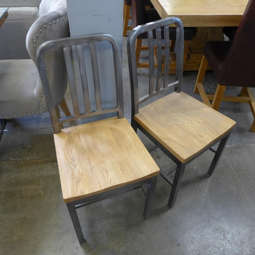 1697 - A pair of oak and steel side chairs...