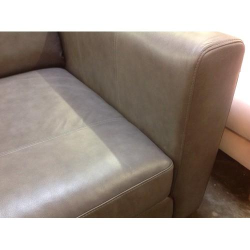 1653 - A grey leather corner sofa...