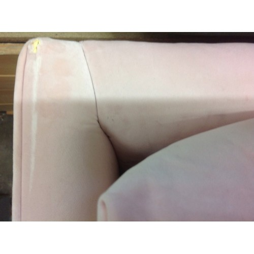 1654 - A pink velvet L-shaped sofa - small tear, marked...