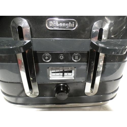 3011 - Delonghi Black Avvolta Four Slot Toaster    (215-556) * This lot is subject to VAT...