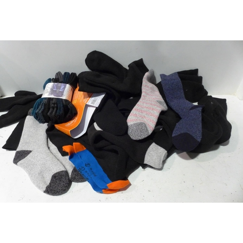 Box of mixed size/style socks (inc. Heat, penguin, etc.) * This lot is subject to VAT