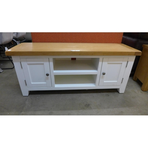 1320 - An oak and white TV stand  *This lot is subject to VAT