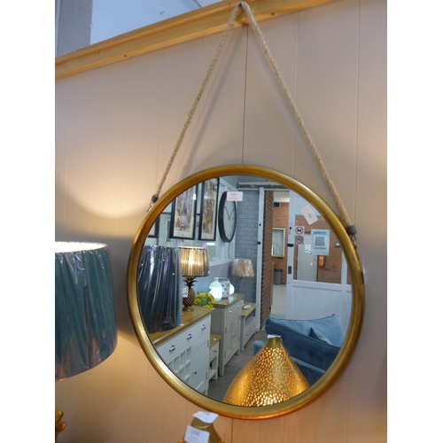 1324 - A large round gold mirror on a hanging rope, 58cm (JRG1114)   #...