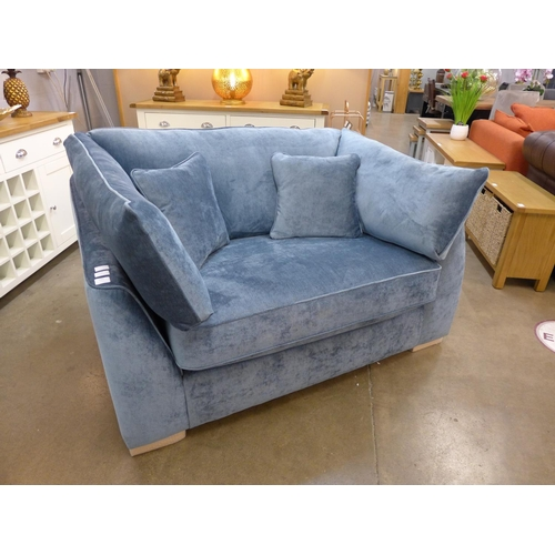 1403 - A sky blue upholstered love seat...