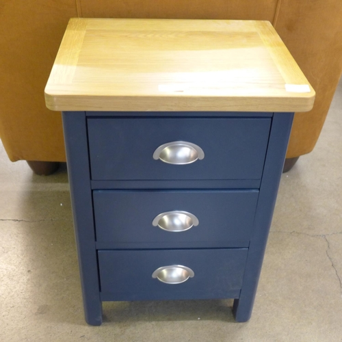 1424 - A Rutland blue painted oak 3 drawer narrow bedside (RA-SBSC-B) * this lot is subject to VAT...