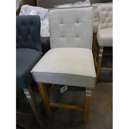 1458 - A pair of Raven cream upholstered bar stools...