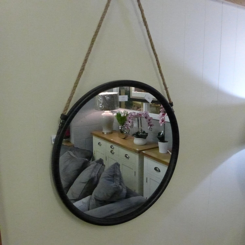 1466 - A circular black framed mirror with rope hanger, 58cms, (JRG1714)   #