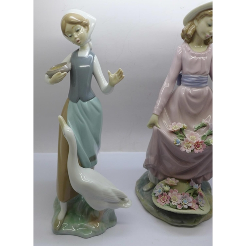 606 - Three Lladro figures; Girl feeding a goose, Flower Curtsey and Girl with lamb and wheelbarrow...
