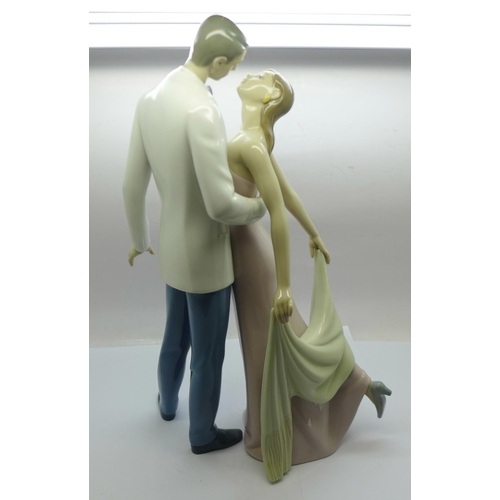 607 - A Lladro figure group, Happy Anniversary...