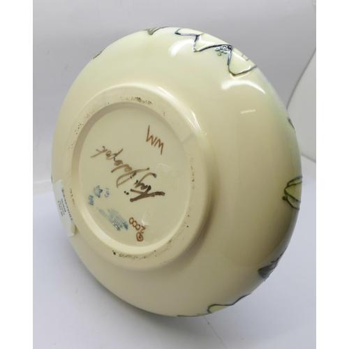 611 - A Moorcroft Juneberry vase, designed by Angela Davenport, signed on the base, 24cm, boxed...