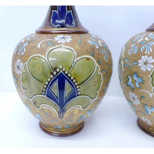 617 - A pair of Royal Doulton Slater's Patent stoneware vases with long flared necks, 40cm...