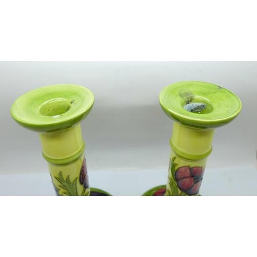 620 - A pair of Moorcroft Anemone candlesticks, 21cm...
