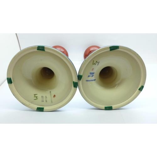 621 - A pair of Moorcroft Tulip candlesticks, 21cm...