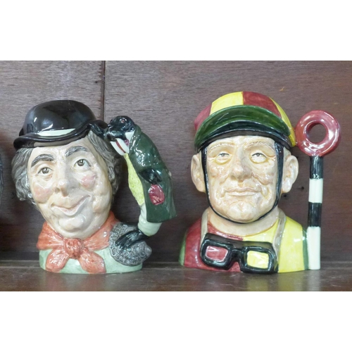 622 - Four Royal Doulton character jugs, Fife Player, Fireman, North Staffordshire Drummer Boy and Artful ...